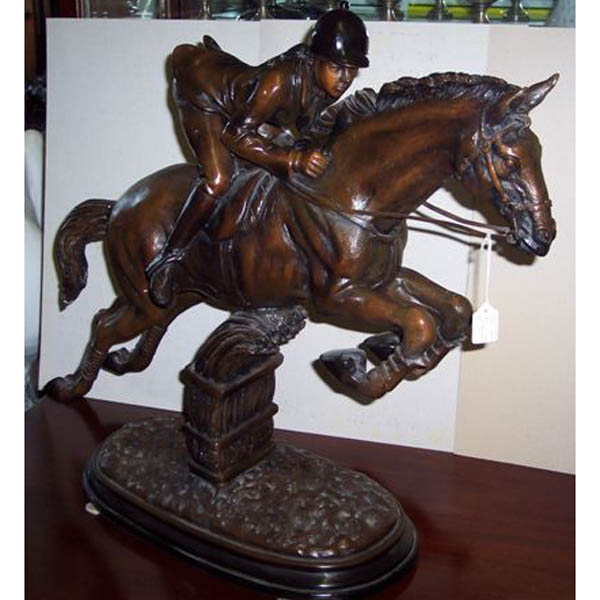 Bronze Jockey on a Horse Jumping